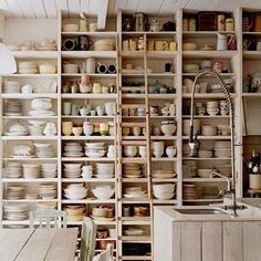 kitchen with shelves of dishes.