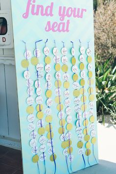 punched out escort cards // photo by Color Me Rad // styling by laceandlikes // view more: http://ruffledblog.com/aqua-pink-carlsbad-wedding