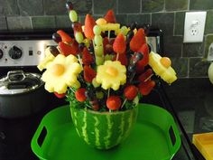 Edible Arrangements at Home:  This was fun to do, but next time I think I will just buy a vase and forget the watermellon. It kept falling while I was sticking fruit into the arrangment. I put extra fruit around the green tray before serving.  PS. It also took 2 hours!