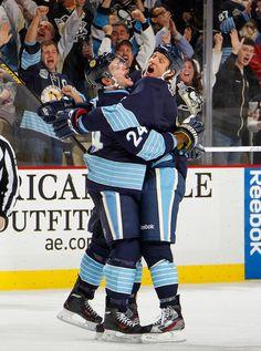 Eaton bear hugs Matt Cooke after his goal against the Islanders 3/30/13. I like their style.
