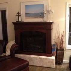 Make an electric fireplace look legit. Built a frame from 2x4s. Yes over engineer it because those suckers are heavy. Veneer with plywood. Choose your tile and put on with liquid nails. I used antique roman 4x4s on the top and prehung mosaic tiles for the front (though i wish i had done all 4x4s)  Make sure the front pieces hang off the left and right the depth of the tile that will be placed on the side. Same with the front for the top tiles. Only grout if you want, I didn't. on the back side, use brackets to connect the fireplace to the frame so it doesn't fall over.