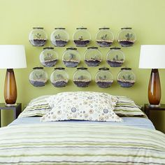 What a cool idea for a boys bedroom! Here, inexpensive plastic fishbowls are used to create a unique headboard perfect for a child who  loves to play outdoors!