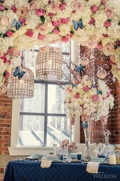 Stunning table with Pink and white flowers and blue butterflies. With hanging chandelier's WedLuxe –  Photography by: Leanne Pedersen Photographers
