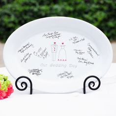 Remember who attended your big day in a stylishly fun way with this unique wedding guest book platter. Instead of (or in addition to) signing your guest book, guests sign this lovely ceramic platter that comes with a black display easel.