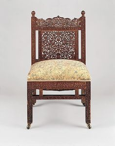 Chair  Designed by Lockwood de Forest (1850–1932)  Date: ca. 1881–86 Geography: Ahmedabad, India; Mid-Atlantic, New York City, New York, United States Culture: American Medium: Probably teak; silk embroidery on linen