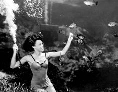 Frances Dwight feeding the fish as a part of the underwater show at Weeki Wachee Springs