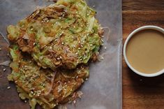 Okonomiyaki - Japanese street food recipe with shrimp, cabbage, scallions, eggs and a sauce made of mayonnaise, soy sauce and sriracha. Source: Food52, where the reviewers were in love with this recipe.