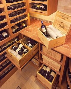Sliding drawers make wine cases easy to access in this custom cellar by Revel.