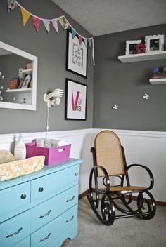 grey unisex nursery with fun colors