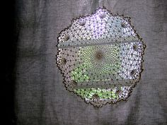 Fabric with a doily appliqued on and then the fabric cut away. Such a pretty look for a window.