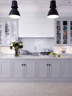 Beautiful kitchen- tile, cabinets , lighting