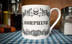 The New Apothecary Morphine Cup. Coffee mug, tea cup, coffee cup with skull illustration.