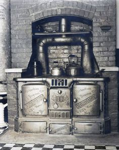 The original Perfect coal-powered stove that was in our kitchen. This puppy had to run 24 hours a day. Photo is dated 1949, though I have no idea when this was removed. Check out the address on the doors - 234 Water Street, NY. Think they're still making cast iron stoves at that address?