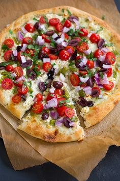 Greek Pizza  - covered with feta, mozzarella, grape tomatoes, red onion, bell pepper, kalamata olives, garlic and parsley. So so good! @Jaclyn Booton Booton Booton Booton Booton {Cooking Classy}