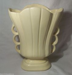 seller says it's a 1947 Hull Pottery Mardi Gras-Granada line   9 1-4in  tall, 7in wide and 3 3-4in deep. Marked on the bottom USA 216-9