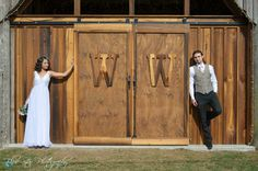 These sliding barn doors make a great backdrop for wedding pics. They also provide a really cool way to make a grand entrance into the barn <3