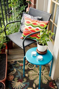 small porch decorating ideas... vertical gardening, small table, chair... love this idea for an apartment patio