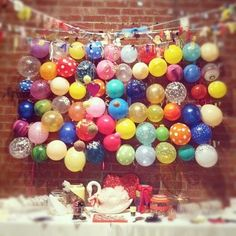 Construct a balloon backdrop by covering an entire wall with balloons. This would look fab behind a dessert bar or even a photo booth