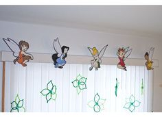 Tinkerbell Party Theme - Fairies made from Disney Cricut cartridge, hanging flowers made from pipecleaners and beads