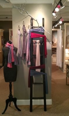 A great way to display scarves....I am pulling out the ladder!