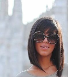 This medium length hair looks great with those bangs. I love this haircut! Maybe when im sick of my hair
