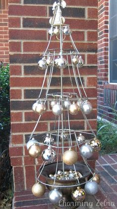 They ways to decorate this are endless! Like the personality of the lamp shades, but a tomato cage flipped upside down could work too. holiday, lamp shade, lampshades, christmas tree ideas, christma tree, christma idea, lampshad christma, light, christmas trees