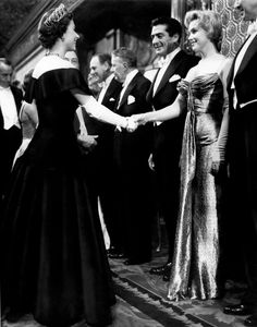 Marilyn Monroe meeting Queen Elizabeth II in England, 1956 or Queen Elizabeth meeting Marilyn Monroe. Had to be an interesting moment for both