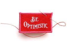 """Be Optimistic"" felt badge from Best Made  (based on old anonymous design, with proceeds donated to It Gets Better Project)"