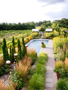 Beautifully landscaped grounds are the backdrop to an expansive pool.