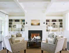love the mantel flanked with shelves. but like the white molding and black fireplace. Traditional Home