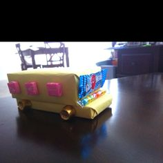 We wrapped up boxes of candy and glued on windows and wheels made of candy of course !   For natalies bus driver  :)