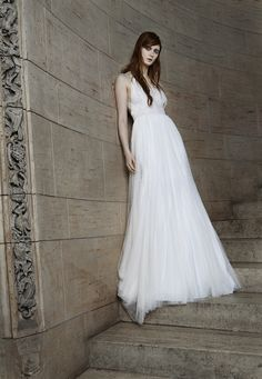 Look 12. Ivory and nude tulle A-line gown with lace trim detailing on bodice and skirt.
