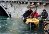 Only in Venice do you stop for coffee during the flood