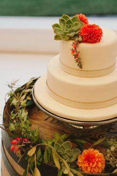 fondant wedding cake, photo by Love Made Visible http://ruffledblog.com/franschhoek-valley-wedding #weddingcake #dahlias #cakes