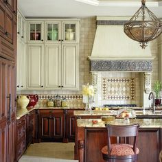 Light upper cabinets with dark lower ones