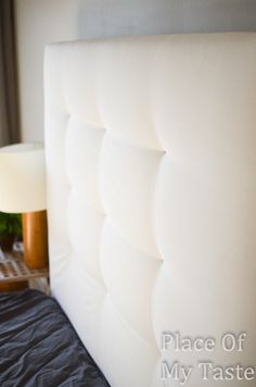 DIY Tufted Headboard - BRILLIANT idea. They stapled where the buttons would go and hot glued them on instead of drilling, pulling string through, cutting through the batting, that whole pain. Awesome!