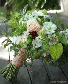 Rambling,twisting,overflowing natural early summer bouquet. Details include wisteria vine,bupleurum,pincushion flowers, chocolate cosmos,maiden hair fern.