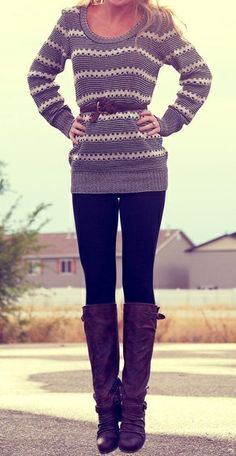 long striped sweater, black leggings, and boots