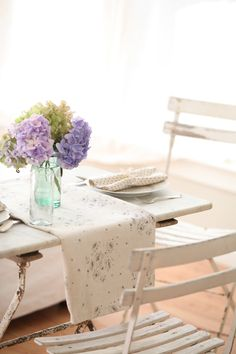 Vintage table runner and polka dot napkins.  Super cute!