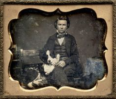 ca. 1855, [portrait of a young gentleman seated with his dog]