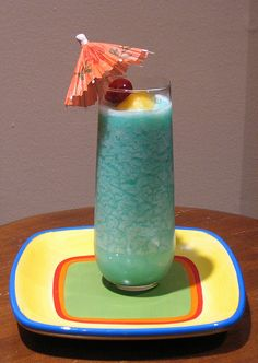 fresh pineapple and coconut creme and rum and blue curacao
