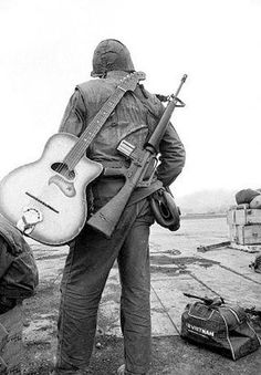 Two sides of Vietnam - Gun and guitar.