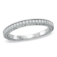 1/7 CT. T.W. Diamond Milgrain Anniversary Band in 10K White Gold - Zales. I also think this could be pretty for my ring, simple and elegant!