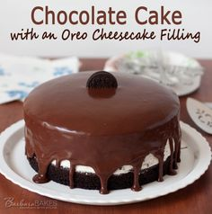 An easy-to-make, creamy no-bake Oreo cheesecake filling sandwiched between rich, moist chocolate cake dripping with a milk chocolate ganache... @Barbara Acosta Acosta Schieving {Barbara Bakes}