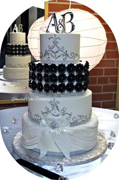Literly the perfect cake even has our initials on it!! Elegant Black and White Wedding Cake. Would love this more without that all black tire