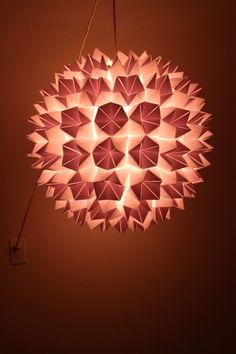A lantern made out of folded paper fortune tellers. Inspiration for a fun DIY project.