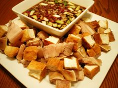 Tokwa't baboy: Pork and tofu in a soy-vinegar sauce that's the traditional partner of Arroz Caldo