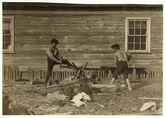 11-year-old boys working a two-man saw - Heart-Breaking Pictures of Child Labour In USA by Lewis Hine. Boys working in Maple Mill, Dillon, S.C. Pete Dunlap (smaller). Said 11 years old. Mannings Dunlap. Both doff-40 cents a day. Location: Dillon, South Carolina.