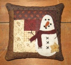 January Pincushion - JJ Stitches kit..could also be used as little pillows in a wooden box or bowl ..this sure is tempting!