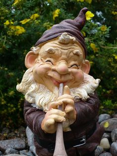 11 Garden Gnome Playing Flute